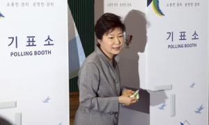 South Korean President Park Geun-hye walks out a voting booth after marking her ballots for the local elections at a polling station in Seoul