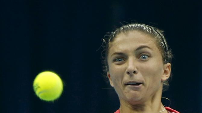 Sara Errani of Italy watches a ball as she hits a return against Andrea Petkovic of Germany during their women's singles match at the China Open tennis tournament in Beijing