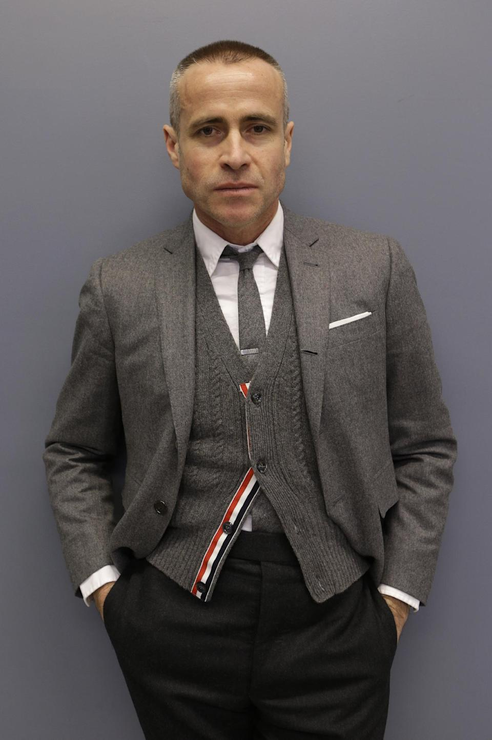 Fashion designer Thom Browne poses for a photograph at his Hudson Street store in New York, Wednesday, Feb. 20, 2013. Browne is building a business _ and what he hopes is a smart, long-lasting business at that. He's just not the overzealous, mercurial artiste. (AP Photo/Kathy Willens)