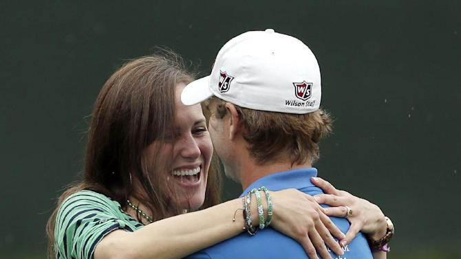 Kevin Streelman, right, hugs his wife Courtney after winning the Tampa Bay Championship golf tournament, Sunday, March 17, 2013, in Palm Harbor, Fla. (AP Photo/Chris O'Meara)