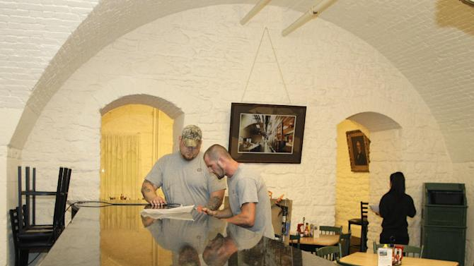 Timothy Back, of Columbus, left, and Vinny Lockridge, of Columbus, install the new counter top at the Statehouse cafe Monday, Aug. 1, 2011, in Columbus, Ohio.  State officials are debating a proposal to establish what would apparently be the nation's first statehouse bar.  (AP Photo/Jay LaPrete)