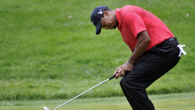 Tiger Woods reacts to a missed birdie putt on the 11th hole during the final round of the Bridgestone Invitational golf tournament at Firestone Country Club in Akron, Ohio, Sunday, Aug. 5, 2012. (AP Photo/Phil Long)