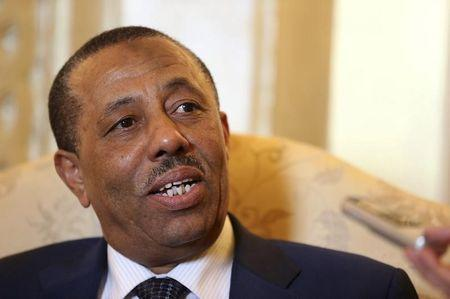 Libya's PM Abdullah al-Thinni speaks to reporters in Abu Dhabi