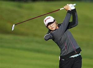 Ko of New Zealand hits an approach shot onto the 15th hole during first round of women's Evian Championship golf tournament in Evian