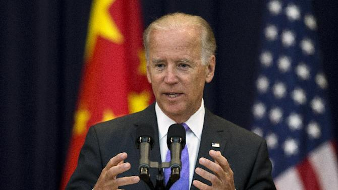 Vice President Joe Biden gestures while speaking at the opening session of the 2013 Strategic and Economic Dialogue, Wednesday, July 10, 2013, at the State Department in Washington. A month after the presidents of the U.S. and China held an unconventional summit at a California resort, their top officials are convening in more staid surroundings in Washington to review security and economic issues that reflect growing ties but also deep-seated differences between the world powers. (AP Photo/Evan Vucci)