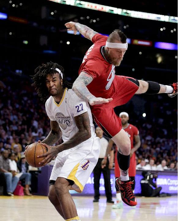Miami Heat forward Chris Andersen, right, fouls Los Angeles Lakers center Jordan Hill during the first half of an NBA basketball game in Los Angeles, Wednesday, Dec. 25, 2013