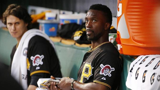 Pittsburgh Pirates' Jeff Locke, left, sits in the dugout next to Andrew McCutchen after pitching the first inning of a baseball game against the Milwaukee Brewers in Pittsburgh, Saturday, April 18, 2015. (AP Photo/Gene J. Puskar)