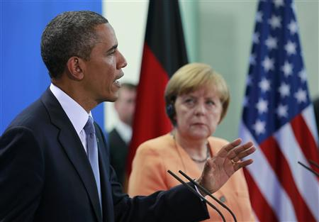 U.S. President Obama speaks next to German Chancellor Merkel during a news conference after their meeting at the Chancellery in Berlin