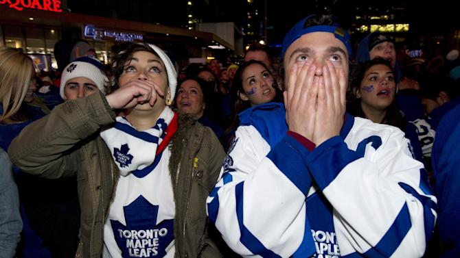 Toronto Maple Leafs fans react to the Boston Bruins' overtime game winning goal in game 7 first round NHL action while watching the game at Maple Leafs Square in Toronto on Monday May 13, 2013. (AP Photo/The Canadian Press, Frank Gunn)