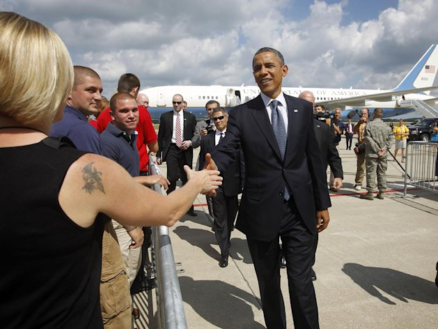 President Barack Obama shakes hands on the tarmac upon his arrival at Mansfield Air National Guard Base in Mansfield, Ohio, Wednesday, Aug. 1, 2012. Obama is campaigning in Ohio with stops in Mansfield and Akron today. (AP Photo/Pablo Martinez Monsivais)
