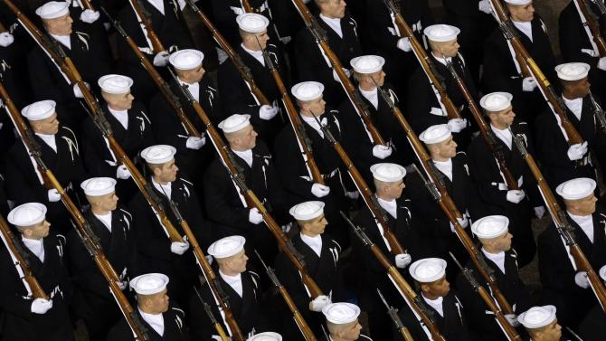 United States Navy Active Company  walk down Pennsylvania Avenue en route to the White House, Monday, Jan. 21, 2013, in Washington. Thousands  marched during the 57th Presidential Inauguration parade after the ceremonial swearing-in of President Barack Obama. (AP Photo/Charlie Neibergall)