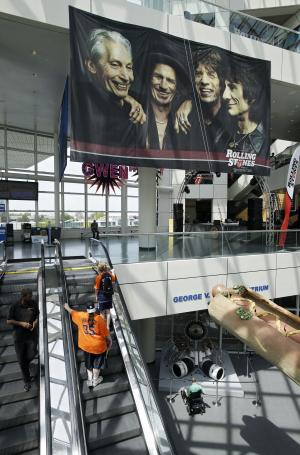 """In this May 21, 2013 photo, a large banner for a new exhibit, """"Rolling Stones 50 Years of Satisfaction"""", greets visitors in the main atrium at the Rock and Roll Hall of Fame in Cleveland.  The exhibit opens on Friday. (AP Photo/Mark Duncan)"""