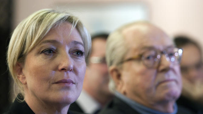 French far-right leader and National Front Party candidate for the 2012 French presidential elections, Marine Le Pen attends  a meeting with the party's former president and her father Jean-Marie, right, in Paris  on Tuesday, Feb. 21, 2012. (AP Photo/Jacques Brinon)