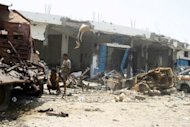 Armed Yemeni locals inspect a heavily destroyed area in Zinjibar on June 19 as Yemeni forces continued their offensive against Al-Qaeda loyalists. Yemen's success in ousting Al-Qaeda from its southern strongholds this month has cemented President Abdrabuh Mansur Hadi's credibility, but analysts warn more challenges lie ahead for the new leader