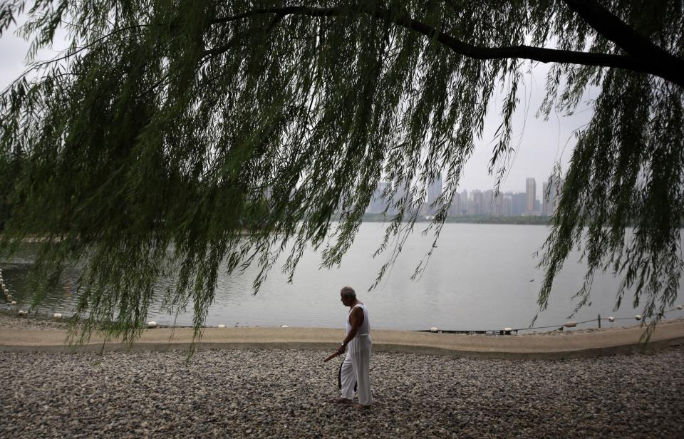 A man walk at a park near the Hefei City Intermediate People's Court Wednesday Aug. 8, 2012 in Hefei, Anhui Province, China. The murder trial of Gu Kailai, wife of ousted Chinese politician Bo Xilai, will start Thursday at the court. (AP Photo/Eugene Hoshiko)