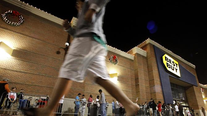 Shoppers stand in line outside a Best Buy department store before the store's opening at midnight for a Black Friday sale, Thursday, Nov. 22, 2012, in Arlington, Texas. Black Friday, the day when retailers traditionally turn a profit for the year, actually got a jump start this year as many stores opened just as families were finishing up Thanksgiving dinner. Stores are experimenting with ways to compete with online rivals like Amazon.com that can offer holiday shopping deals at any time and on any day.  (AP Photo/Tony Gutierrez)