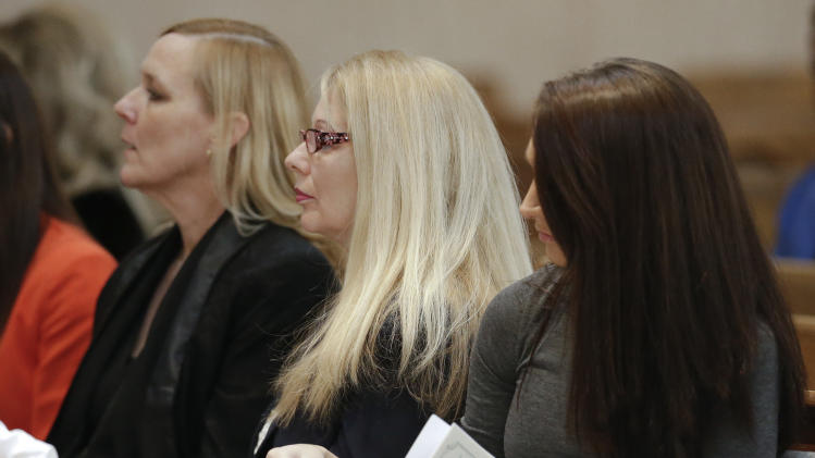 Gayle Inge, center, mother of country singer Mindy McCready, attends a memorial service for McCready on Wednesday, March 6, 2013, in Nashville, Tenn. McCready committed suicide Feb. 17 in Heber Springs, Ark. (AP Photo/Mark Humphrey)