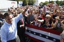 U.S. Republican presidential nominee Romney waves to supporters at a campaign rally in Fairfax