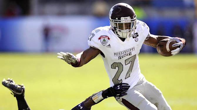 Mississippi State running back LaDarius Perkins (27) eludes a tackle by Northwestern safety Jared Carpenter (27) during the first half of the Gator Bowl NCAA college football game, Tuesday, Jan. 1, 2013, in Jacksonville, Fla. (AP Photo/Stephen Morton)