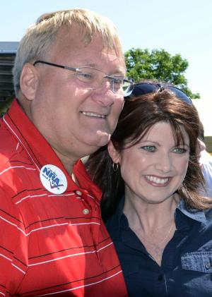 FILE - In this June 2, 2012 file photo, Wisconsin Lt. Gov. Rebecca Kleefisch, right, poses for a photo with state Sen. Van Wangaard at a rally held by the Racine Tea Party PAC in Gorney Park in Caledonia, Wis. Sen. Wanggaard asked elections officials Friday, June 15, 2012, for a recount in his recall race, the outcome of which will decide the majority party in the state Senate. Democrats had called on Wanggaard to concede, saying a recount would only delay their inevitable and waste taxpayer money. But Wanggaard's campaign said it was concerned about possible reports of voting irregularities, and said it wanted to ensure the outcome was accurate. (AP Photo/Mark Hertzberg)