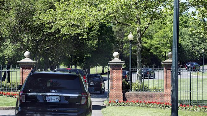 The motorcade carrying President Barack Obama arrives at the Robert Trent Jones Golf Club where the president is expected to play golf in Gainesville, Va., on Saturday, May 17, 2014. (AP Photo/Jacquelyn Martin)