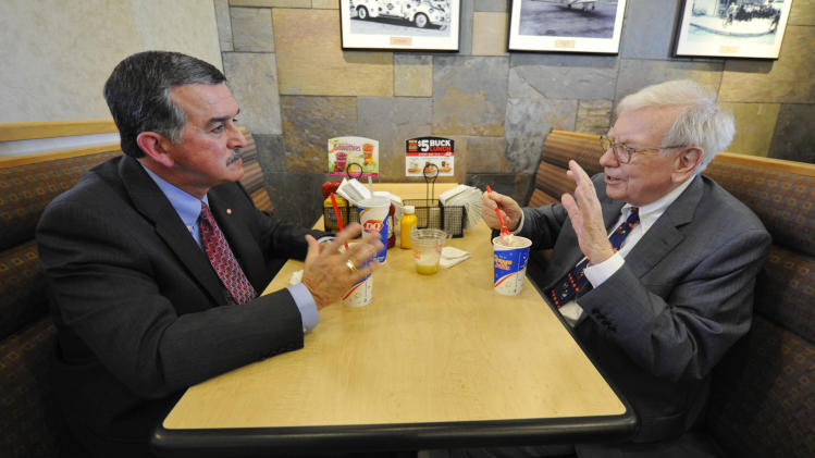 "IMAGE DISTRIBUTED FOR DAIRY QUEEN - Berkshire Hathaway's Warren Buffett, right, and Dairy Queen's CEO John Gainor share lunch on Monday May 20, 2013 in Omaha, Neb. Buffet helped launch the ""The First S'mores Blizzard of Summer"" and was celebrated as Dairy Queen's number one fan.  (Dave Weaver/AP Images for Dairy Queen)"