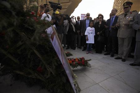 The widow and son of late President Anwar Sadat pay their respects at his tomb in Cairo