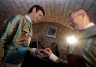 Two French men exchange vows at the marriage hall in Montpellier, France in 2004. Nearly two-thirds of the French back gay marriage, a poll published Tuesday revealed as Catholic bishops urged their followers to pray for the maintenance of traditional family arrangements