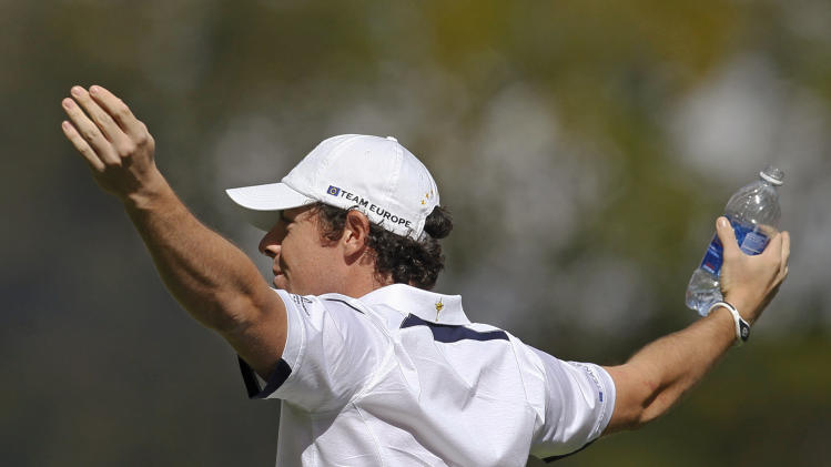 Europe's Rory McIlroy reacts to chants from the crowd on the first tee before a singles match at the Ryder Cup PGA golf tournament Sunday, Sept. 30, 2012, at the Medinah Country Club in Medinah, Ill. (AP Photo/Charles Rex Arbogast)