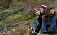 This film image released by IFC Films shows, from left, Mark Duplass, Emily Blunt and Rosemarie DeWitt in a scene from &quot;Your Sister&#39;s Sister.&quot; (AP Photo/IFC Films, Steven Schardt)