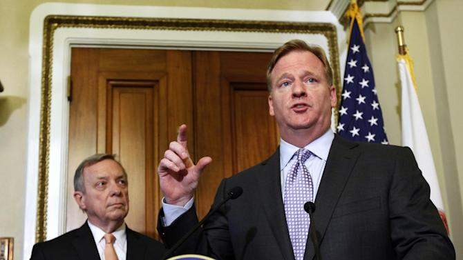 Democratic Whip Sen. Dick Durbin, D-Ill., left, and NFL Commissioner Roger Goodell speak during a media availability after their meeting to discuss bounty programs, on Capitol Hill Wednesday, June 20, 2012 in Washington. (AP Photo/Alex Brandon)