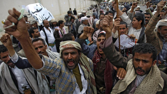 """Yemeni Shiite Hawthi rebels chant slogans demanding the government step down during a demonstration in a street leading to the Interior Ministry in Sanaa, Yemen, Saturday, Aug. 23, 2014. Thousands of supporters of the Hawthi group, a powerful Yemeni Shiite rebel group, escalated their standoff with the government on Friday, setting up tents near three ministries to press for the replacement of Prime Minister Mohammed Salem Bassindwa who they depict as """"manipulated"""" by their rival Islamist group, the Muslim Brotherhood. (AP Photo/Hani Mohammed)"""