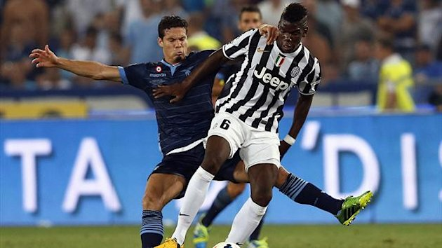 Juventus' Paul Labile Pogba (R) challenges Anderson Hernanes of Lazio during their Italian Super Cup match at the Olympic stadium in Rome August 18, 2013 (Reuters)