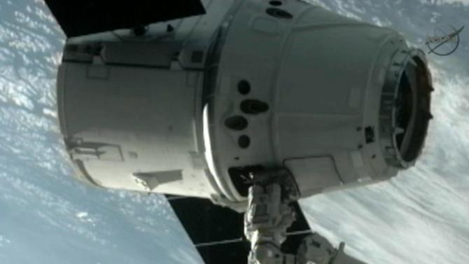 This image provided by NASA-TV shows the SpaceX Dragon commercial cargo craft after Dragon was grappled by the Canadarm2 robotic arm and connected to the International Space Station, Friday, May 25, 2012. Dragon is scheduled to spend about a week docked with the station before returning to Earth on May 31 for retrieval. (AP Photo/NASA)