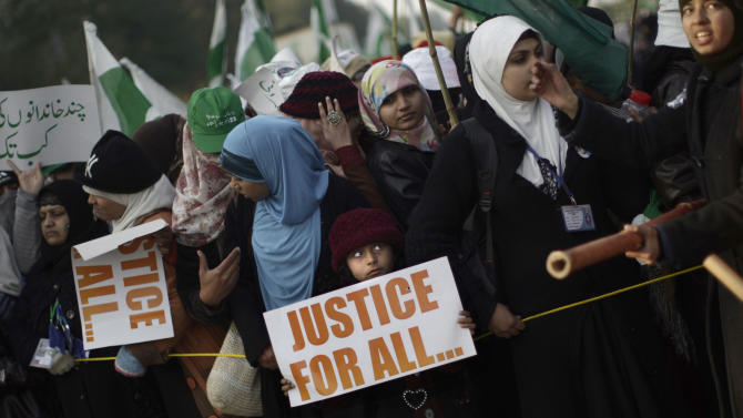 Supporters of Pakistani Sunni Muslim cleric Tahir-ul-Qadri, attend a rally in Islamabad, Pakistan, Tuesday, Jan. 15, 2013. Thousands of anti-government protesters are rallying in the streets of the Pakistani capital for a second day despite early-morning clashes with police who fired off shots and tear gas to disperse the crowd. (AP Photo/Muhammed Muheisen)