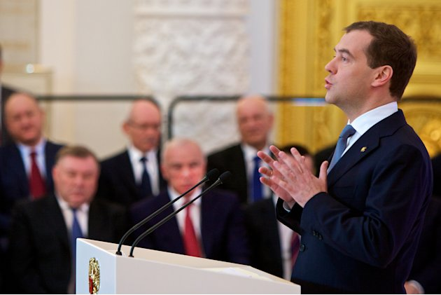 Russian President Dmitry Medvedev, right, addresses the State Council in the Kremlin in Moscow,  Russia, Tuesday, April 24, 2012. Medvedev, who will shift into the prime minister's job after Vladimir