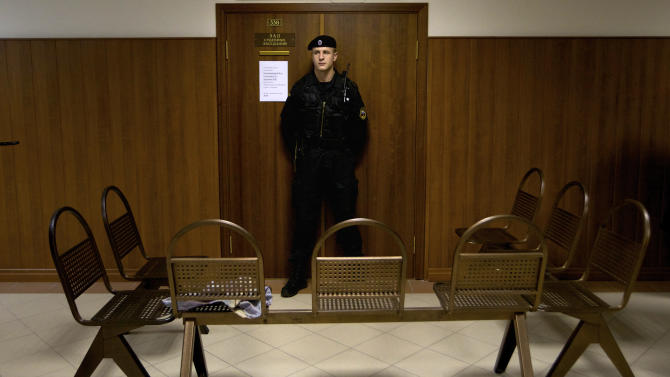 """A policeman guards a court room in Moscow, Russia, on Monday Oct. 1, 2012.  The Russian court is set to hear an appeal filed by three jailed members of the rock band Pussy Riot, but postponed the appeal until Oct. 10 after one of the group fired her lawyers.  The group were sentenced to two years for performing a """"punk prayer"""" against President Vladimir Putin inside Moscow's main cathedral. (AP Photo/Ivan Sekretarev)"""