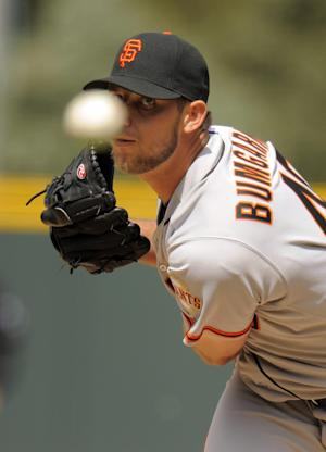 San Francisco Giants starting pitcher Madison Bumgarner throws to the plate against the Colorado Rockies during the first inning of a baseball game on Thursday, April 12, 2012, in Denver. (AP Photo/Jack Dempsey)