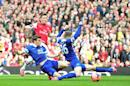 Arsenal's Mesut Ozil (C) scores the opening goal during their 4-1 English FA Cup quarter final win over Everton at the Emirates Stadium on March 8, 2014