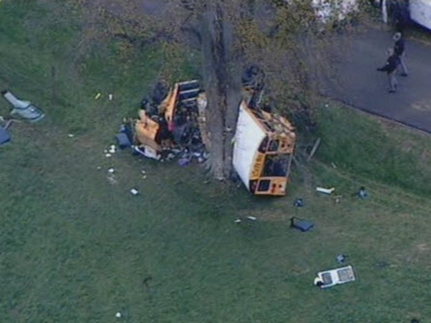 This image taken from video provided by WHAS-TV shows a school bus wreck on Boone Road in Carrollton, Ky. Monday, Oct. 29, 2012. Carroll County Coroner David Wilhoite says there&#39;s been a fatality in the wreck in which the bus turned over with children on board. (AP Photo/WHAS-TV)