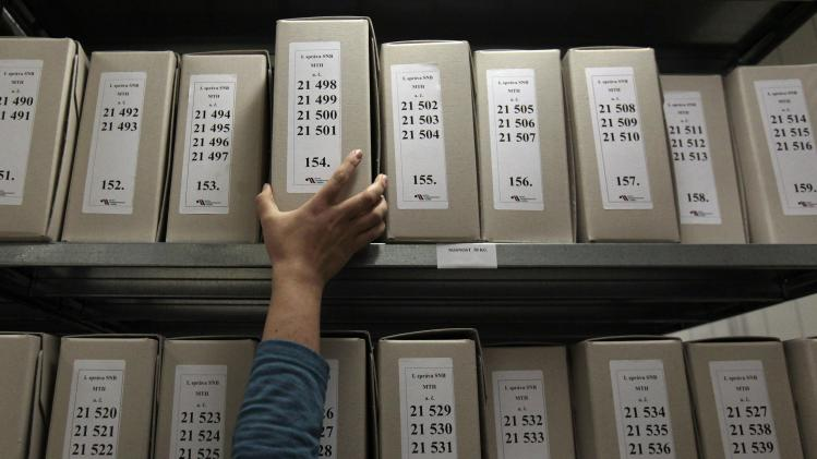 A worker of Security Services Archive searches files in The Institute for the Study of Totalitarian Regimes in Prague