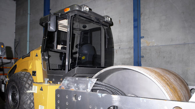 This photo released by the Australian Federal Police shows a steamroller which was used to hide drugs by two men in Sydney, Australia, Wednesday, Nov. 21, 2012. The Australian Federal Police said Wednesday that they arrested a Canadian man and a U.S. man after officers had seized 350kg (770 pound) of cocaine and methamphetamine hidden inside the steamroller shipped from China. (AP Photo/Australia Federal Police)