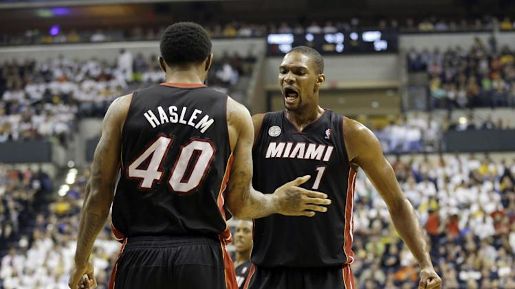 Miami Heat's Udonis Haslem (40) celebrates with Chris Bosh (1) after Haslem made a shot and was fouled during the first half of Game 3 of the NBA Eastern Conference basketball finals against the Indiana Pacers in Indianapolis, Sunday, May 26, 2013. (AP Photo/Nam H. Huh)