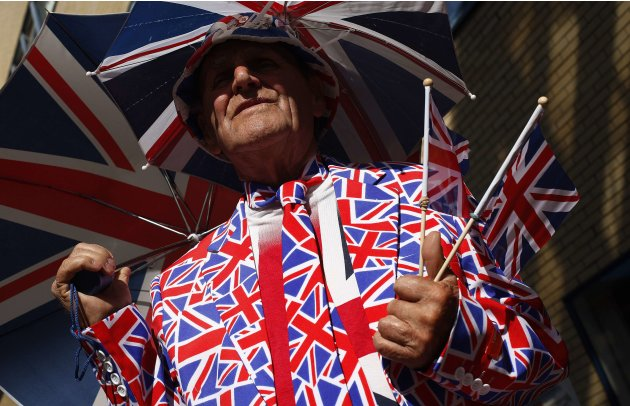 Rule Britannia: A royal supporter is covered in Union Jacks as he stands outside the Lindo Wing of St Mary's Hospital, where Catherine, Duchess of Cambridge is due to give birth (Reuters)