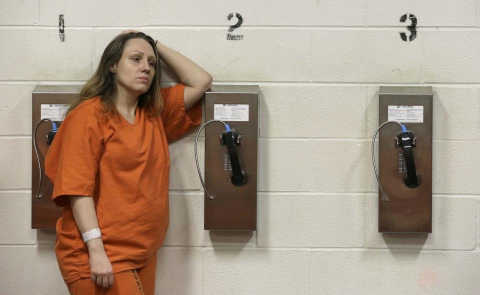 Harris County inmate Kristi Leonard leans against a telephone in her cell block Tuesday, June 4, 2013, in Houston. Arrested numerous times for prostitution, Leonard is part of a rehabilitation program called We've Been There Done That. (AP Photo/Pat Sullivan)