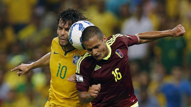 Kaka of Brazil heads a ball with Roberto Rosales of Venezuela during their 2018 World Cup qualifying soccer match in Fortaleza