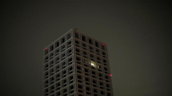 File picture shows lights turned on in an apartment at a residential building in Tokyo