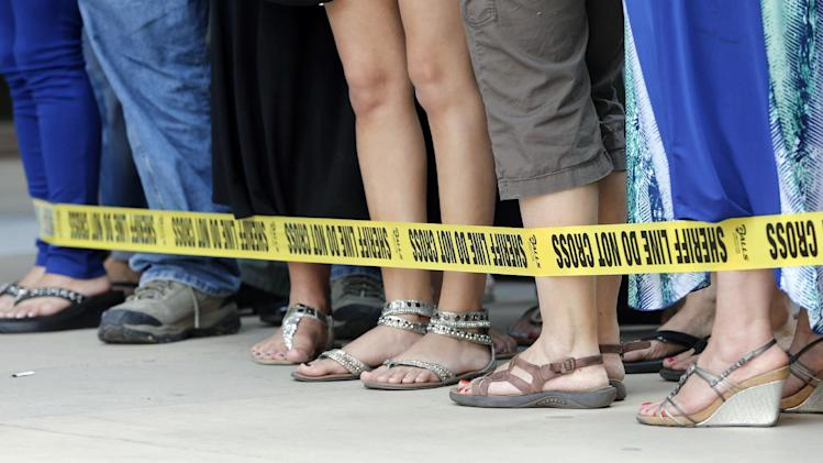 Spectators stand near the front of Superior Court as they wait for a verdict in the murder trial of Jodi Arias, Wednesday, May 8, 2013 in Phoenix. Arias was convicted of first-degree murder Wednesday in the 2009 killing of her one-time boyfriend Travis Alexander after a four-month trial.  (AP Photo/Matt York)