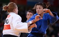 Brazil&#39;s Sarah Menezes (right) competes with Romania&#39;s Alina Dumitru at the London 2012 Olympics on July 28. Olympic judo champion Menezes revealed Sunday that her parents tried to stop her from taking up the sport which they believed was for men only. The 22-year-old from Brazil became the first woman from her country to win an Olympic judo gold