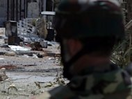 A Syrian soldier inspects the the restive Seif al-Dawlah neighbourhood in Aleppo on September 3. Syrian forces say they they have secured a flashpoint district of Aleppo city after a week of fighting, although an AFP correspondent said some parts were still unsafe for residents to return